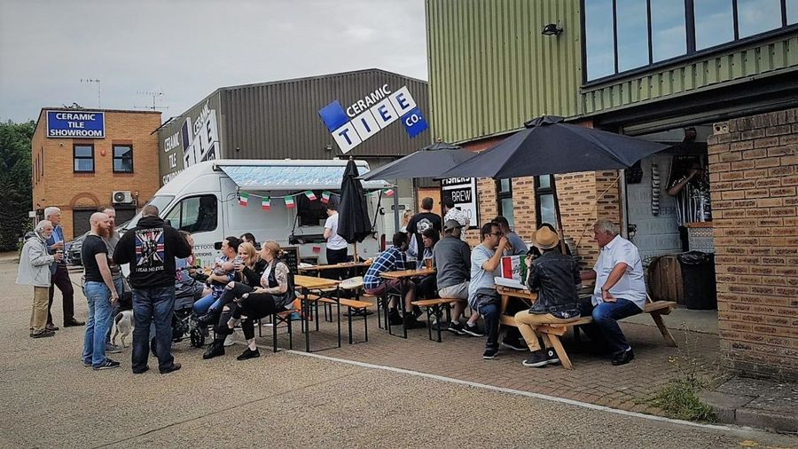 Seating, umbrellas and food van outside Fisher's Brewery