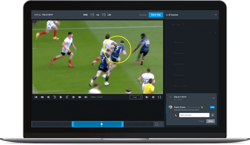 Rugby match video analysis on laptop