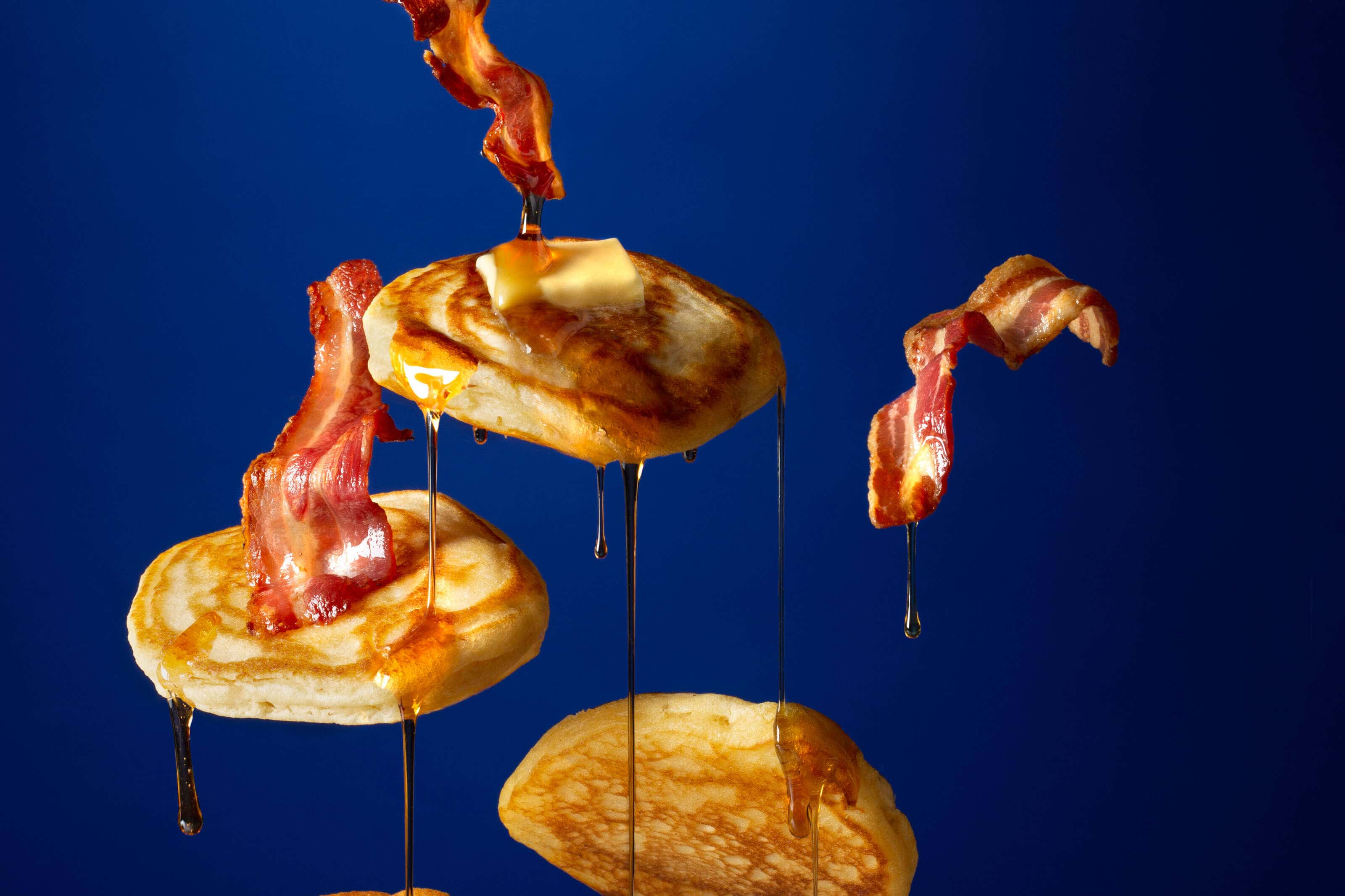 flying-pancake-with syrup dripping off them and melted butter