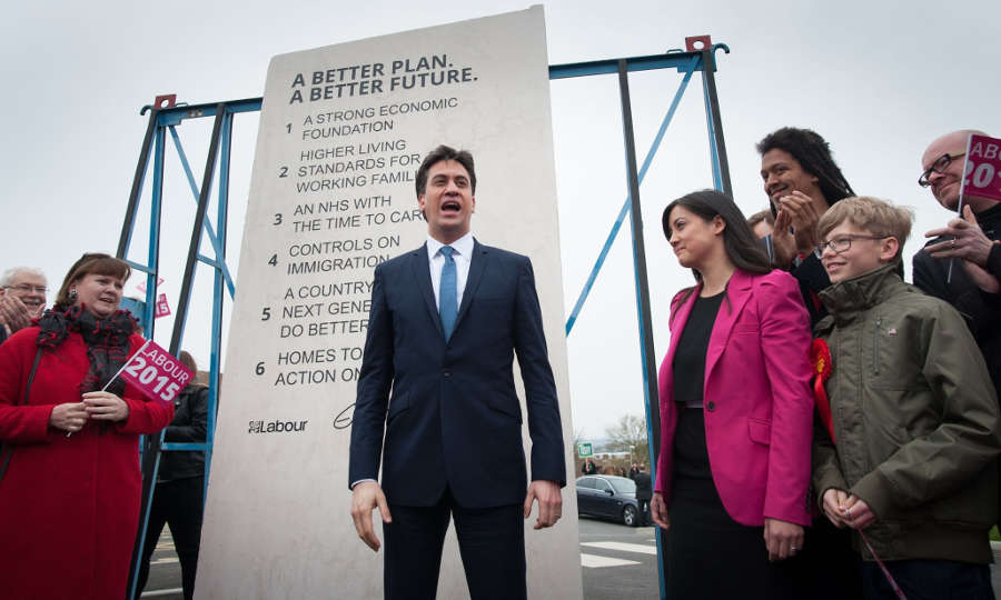 Ed Miliband stands in front of an 8 foot 6 stone
