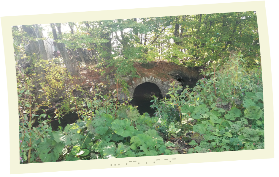 Old Stone Culvert with dark ghostly figure clawing its way up the right hand side