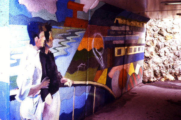 colourful wall mural in an underpass