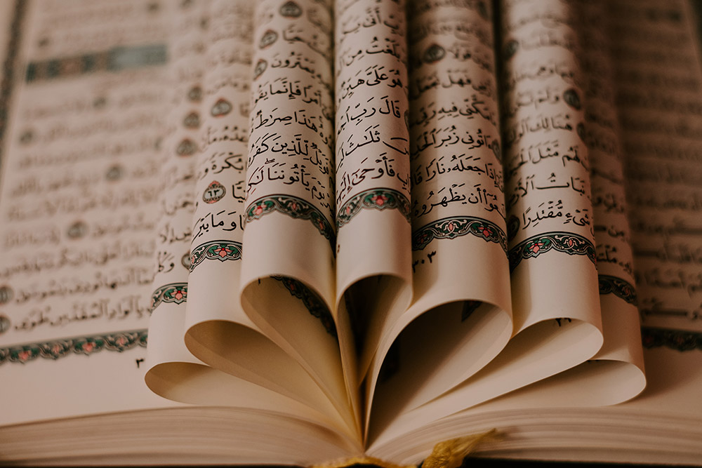 illuminated pages of a book written in farsi