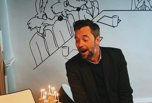 mark blowing birthday candles