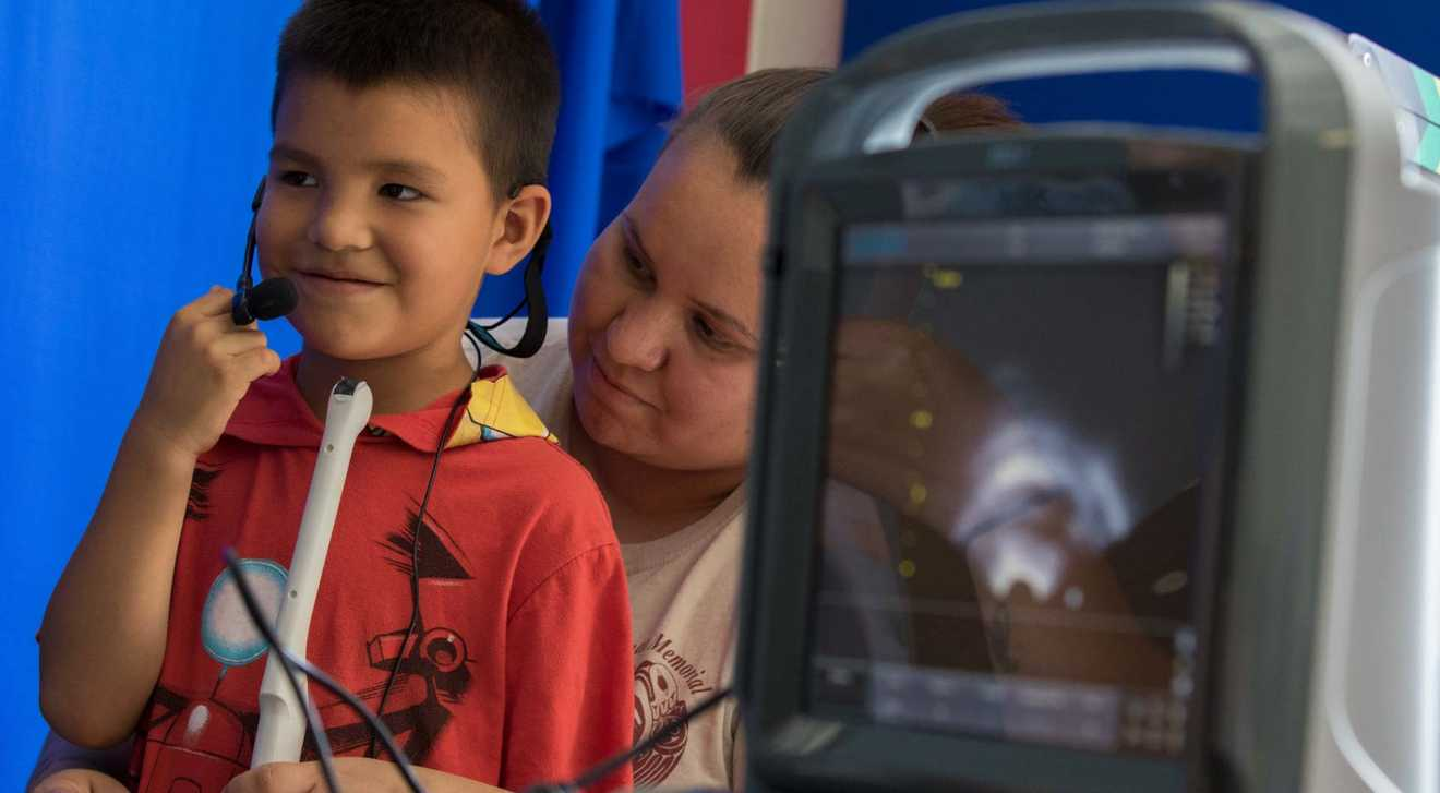 A boy and his mother work to preserve the first language of the W̱SÁNEĆ First Nation of Vancouver Island with the use of an ultrasound device