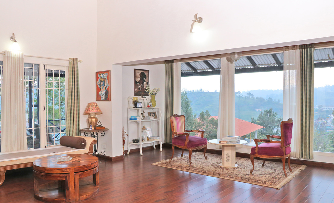 The high-ceiling living room adjoins the Sun room