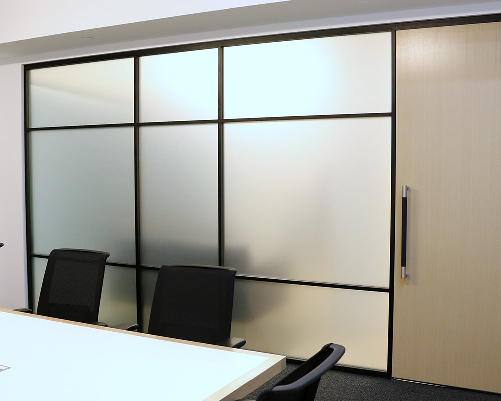 Office Room With Framed and Frosted Glass Walls
