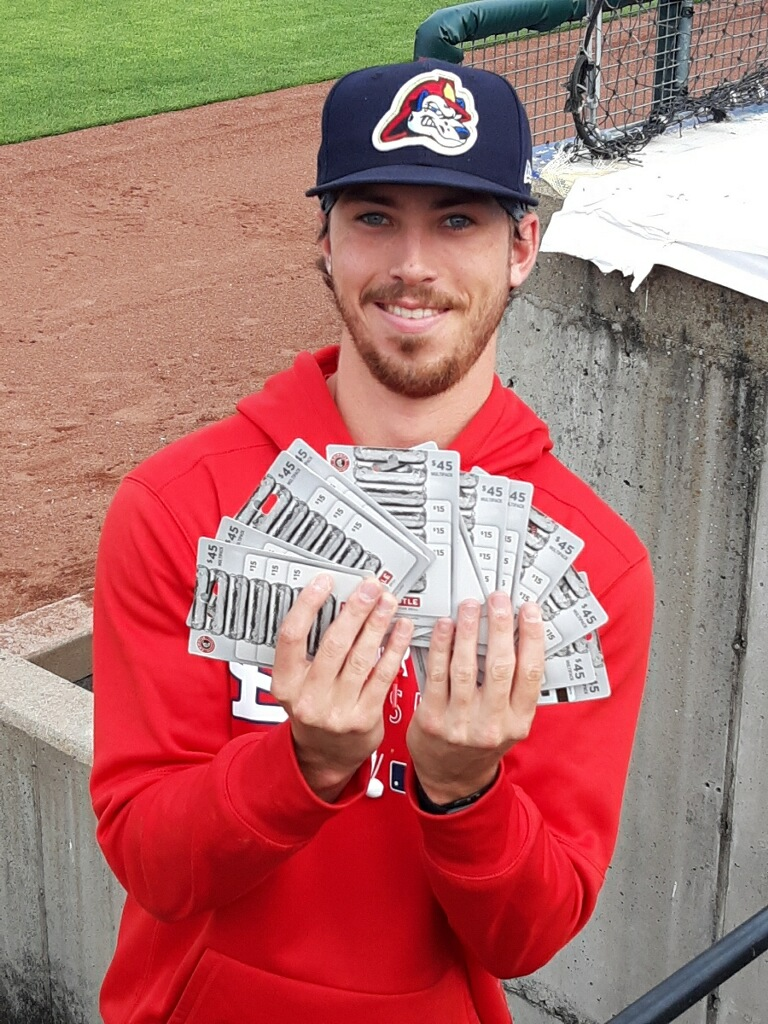 Chiefs player with Chipotle gift cards.