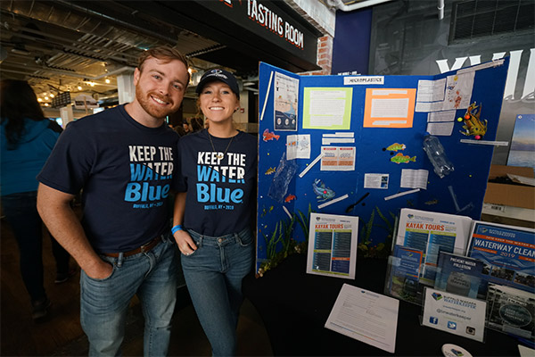 Two employees at a Keep the Water Blue information booth