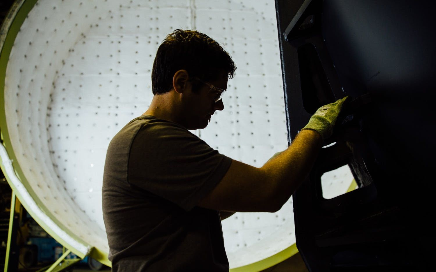Pillar Innovations - Man working on electrical.