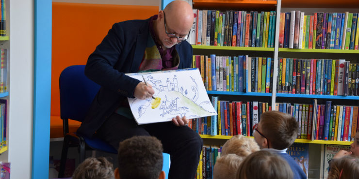 James draws St George and the Dragon upside-down for children at Bungay Library