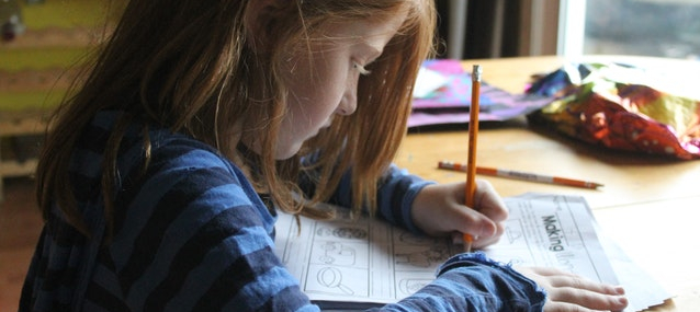 A girl, writing