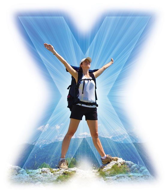 Woman hiker creating X with her arms and legs