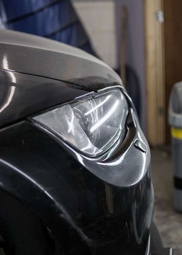 Close up shot of right side BMW 3 series car with poor/bad/dull paint job before polishing