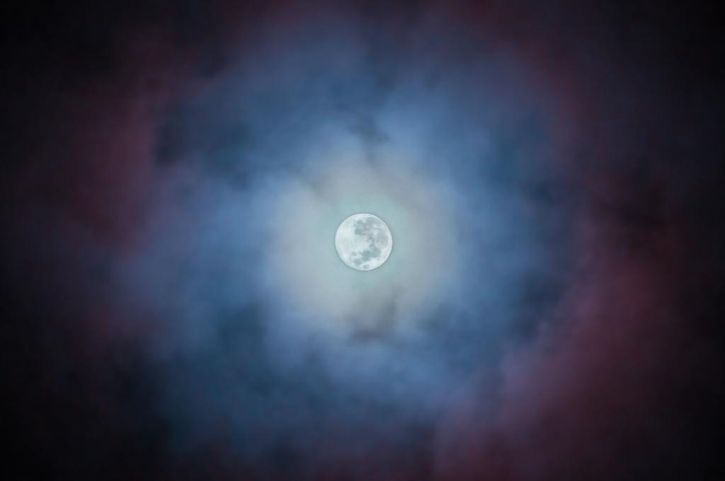 Full moon on blue night background
