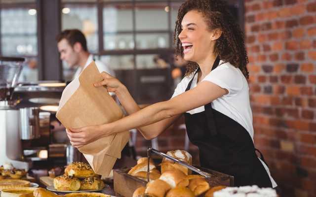 Happy girl serving customers