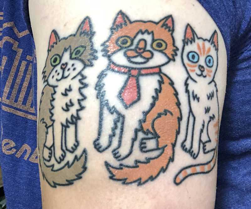 a tattoo of cartoon cats