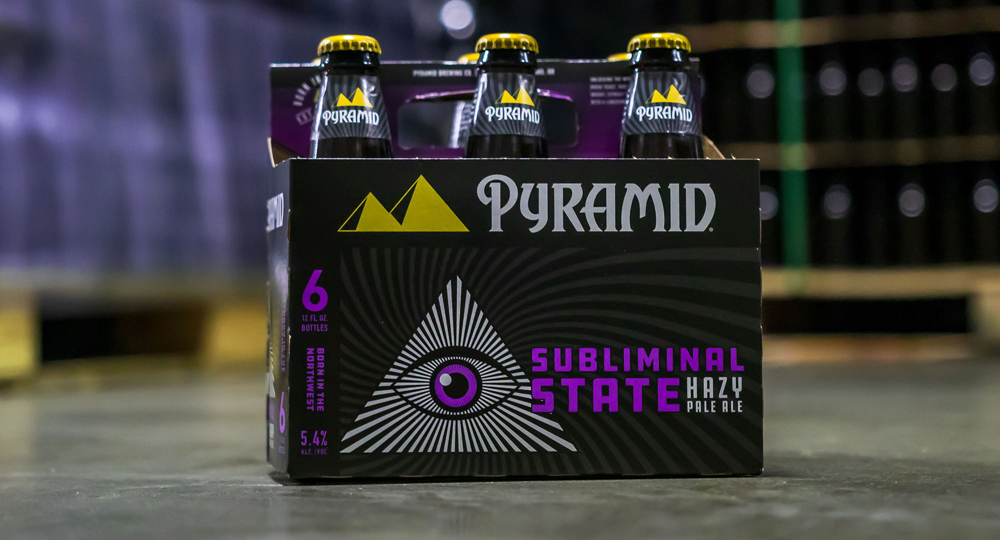 Subliminal State 6-pack on warehouse floor