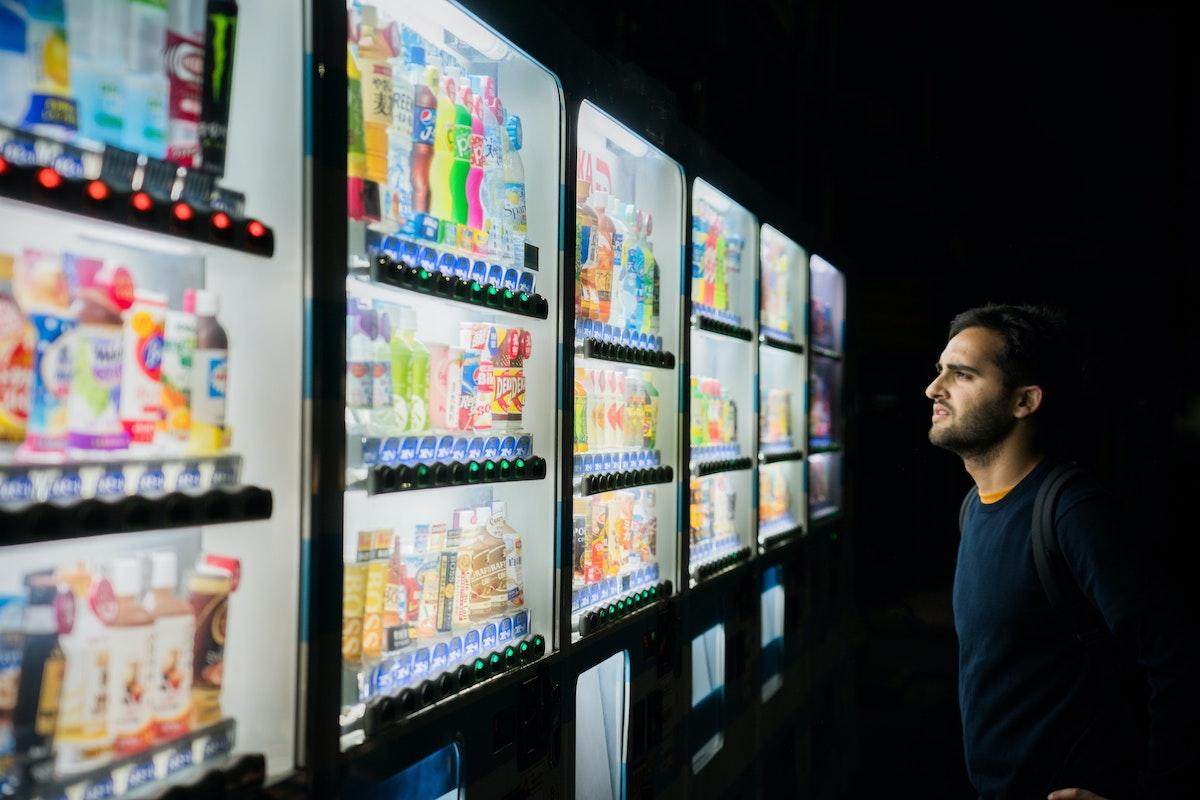 Vending Machine & Man - Photo by Victoriano Izquierdo on Unsplash