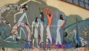 Figure 3: Mural depicting Ma'at from the Book of the Dead and the Goddess Hathor, by Alaa Awad, Mohamed Mahmoud Street, Cairo. Photograph by Soraya Morayef (March 2012)