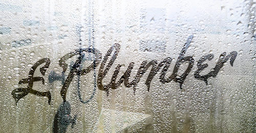 Image of plumbing costs on steamy shower glass
