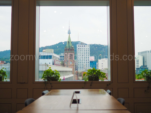 Business Boardroom Virtual Background for Zoom with view of clock tower and buildings outside