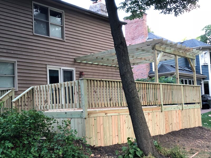 brown colored house with new unfinished deck