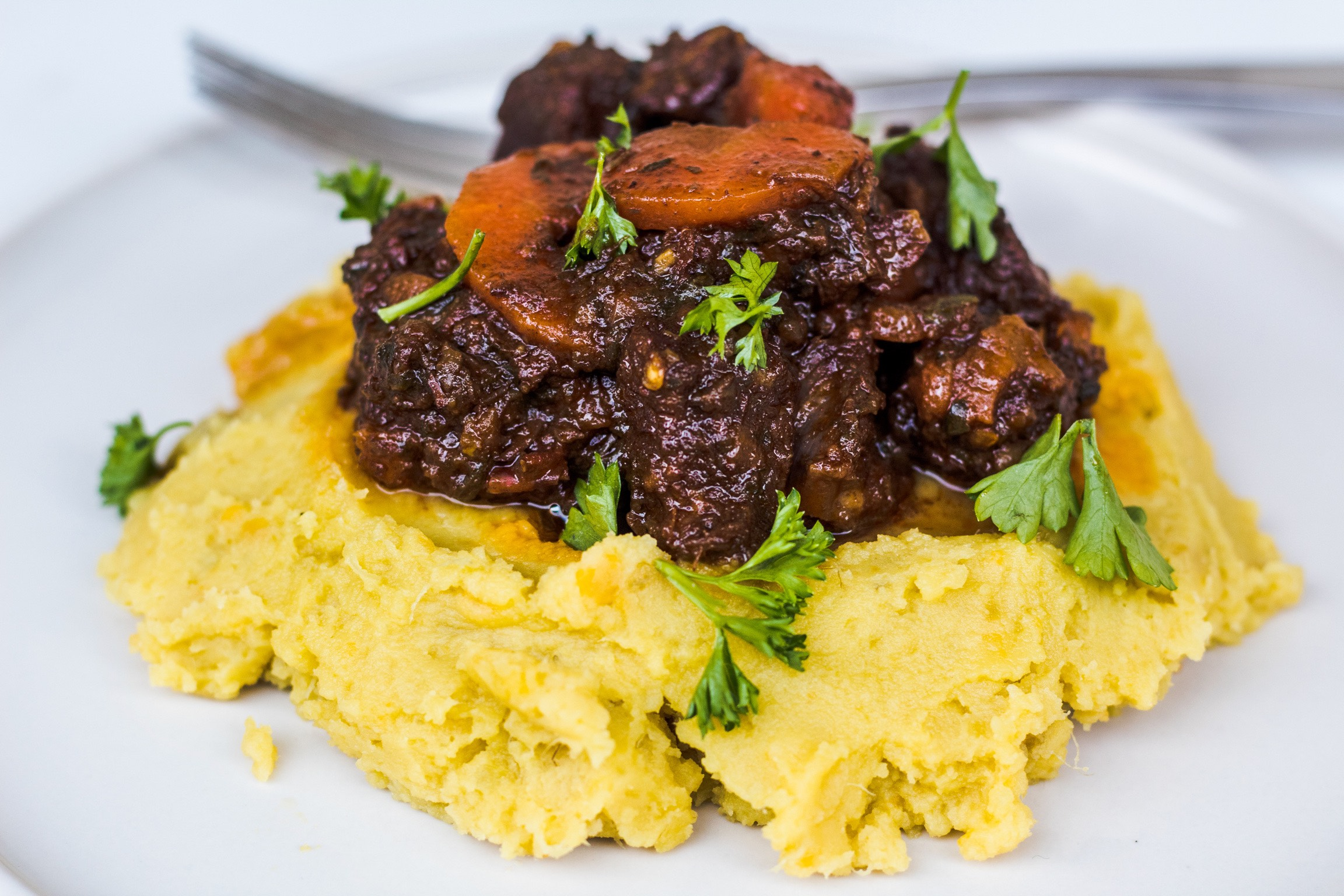 Rich Caribbean stew (stewed) beef and creamy sweet potato mash