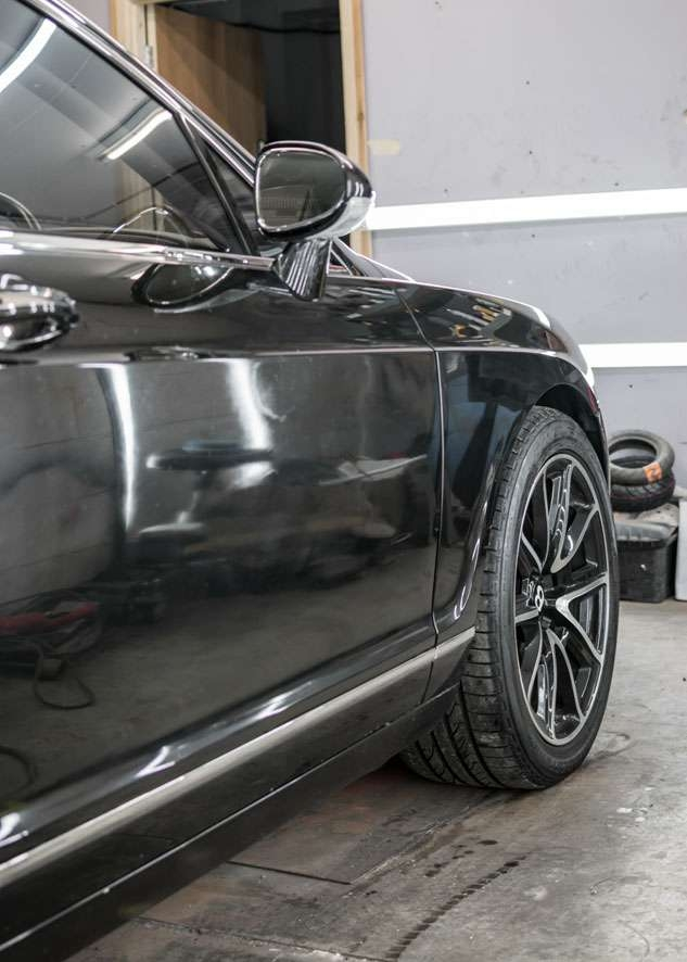 Front side shot of Bentley Flying Spur car with poor/bad/dull paint job and before paint correction