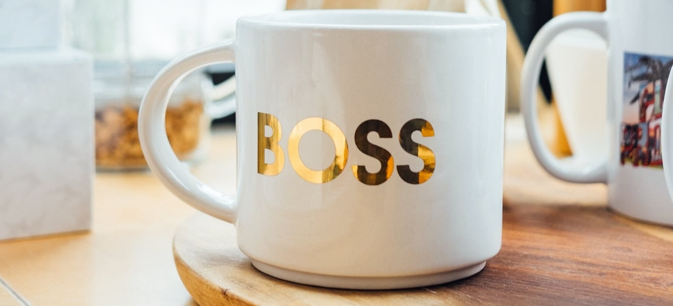 Coffee mug with the word 'Boss' on it.