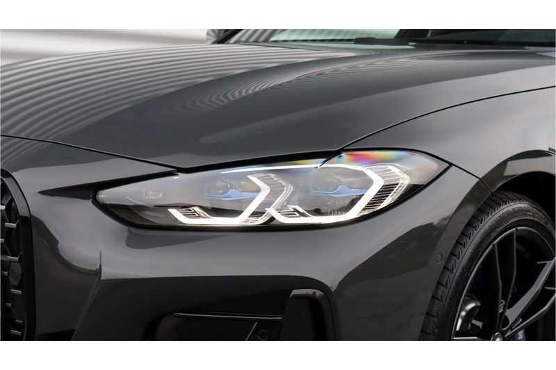 BMW 4 Serie Coupé M440i xDrive High Executive Harman/Kardon, Head Up Display, Schuifdak afbeelding 3