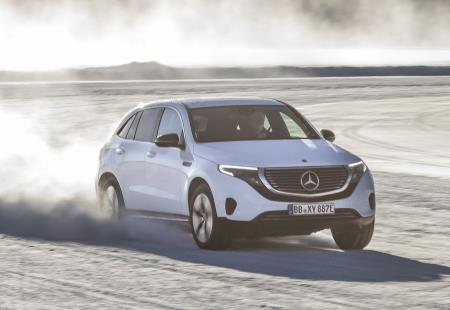Real-car photo from Daimler of the Mercedes Benz EQC 2021, drifting in snowy and icy conditions.