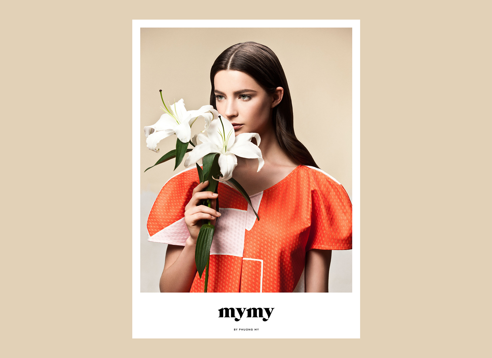 Image of a woman smelling lily's wearing an orange top. MYMY projecy.