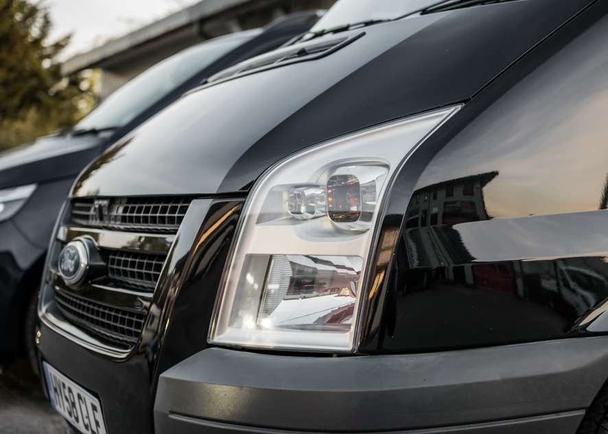 Close up shot of Ford Transit van headlights with fog/cloudiness removed after headlight restoration