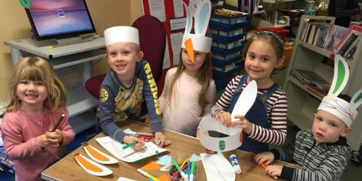 Children making bunny ears at Hadleigh Library