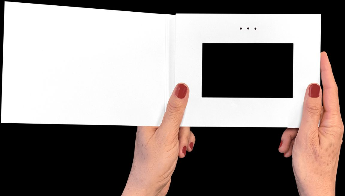 Woman holding Heirloom video book
