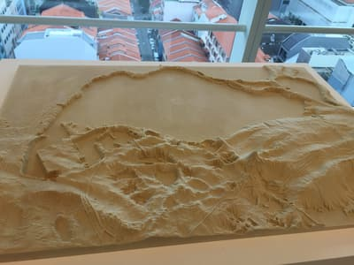 An artistic sand sculpture representing the island of Singapore.
