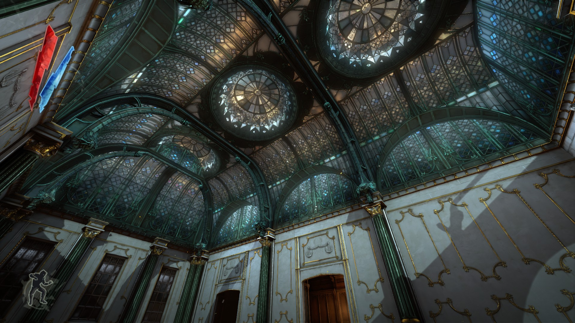 A fancy, stained glass dome roof in a big house.