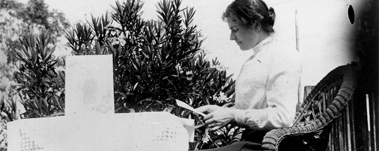 Old photo of lady reading a letter.