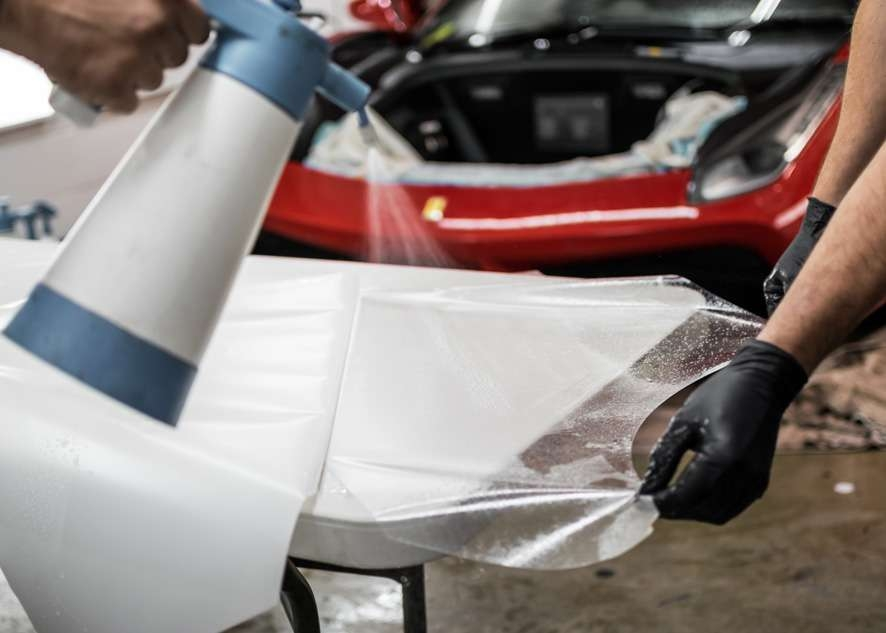 Paint protection film (PPF) being peeled