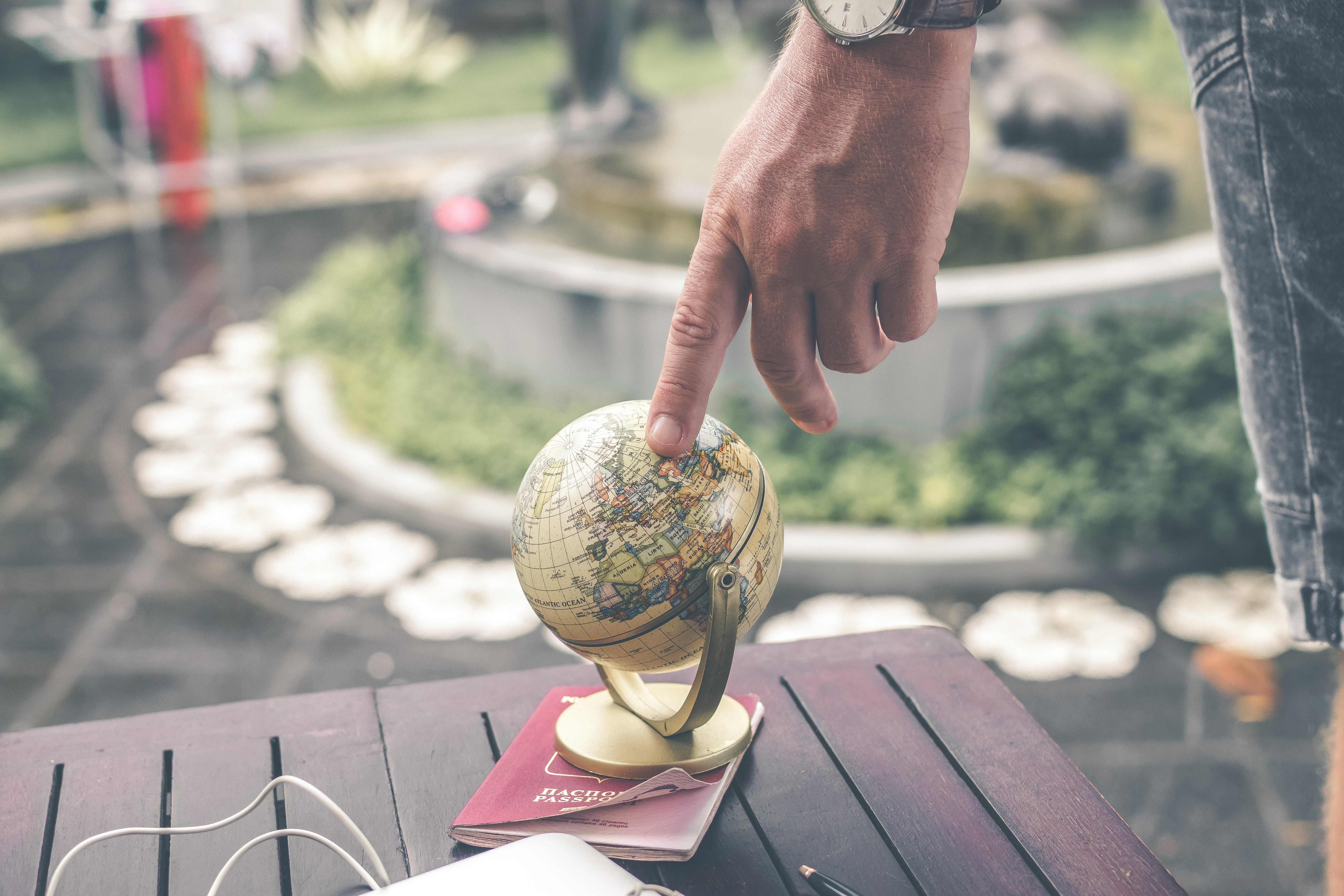 finger pointed to globe representing the article Tricks to Make your Gatsby Localization Project a Success