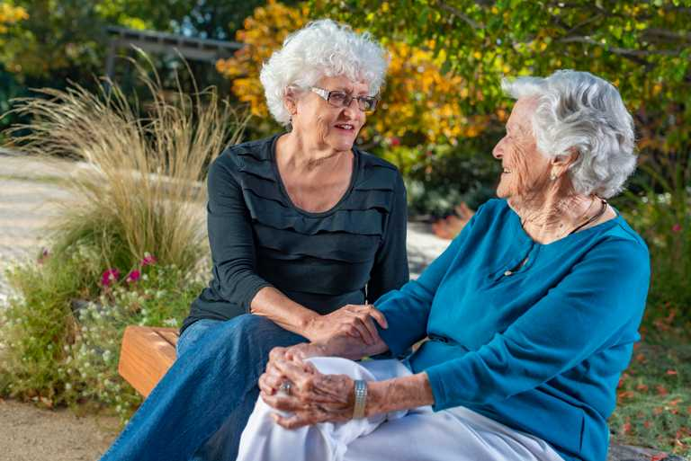 Two women discussing the Caregiver Support Initiative