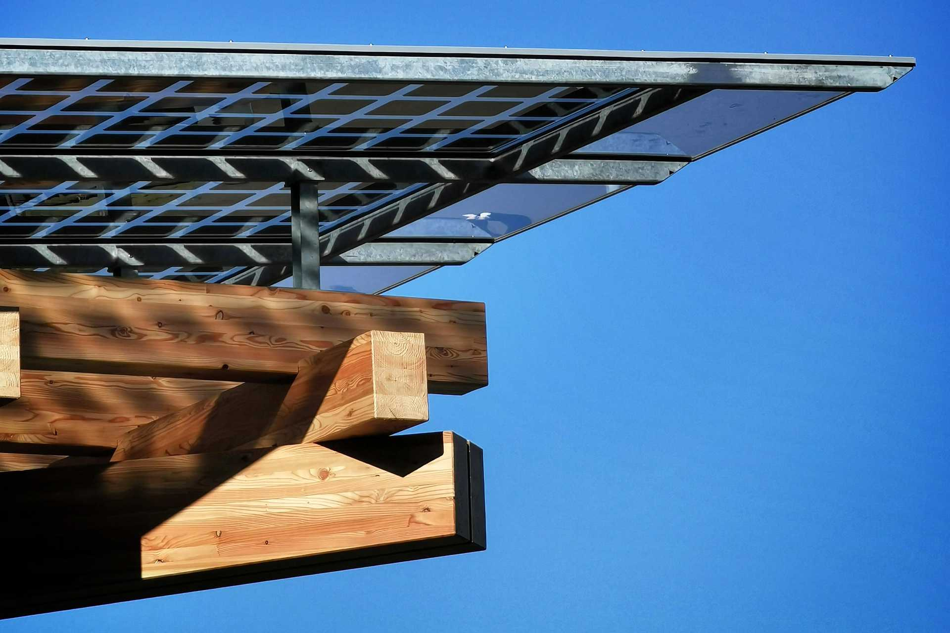 Detail of the K:Port timber structure with photovoltaic panels casting shadows