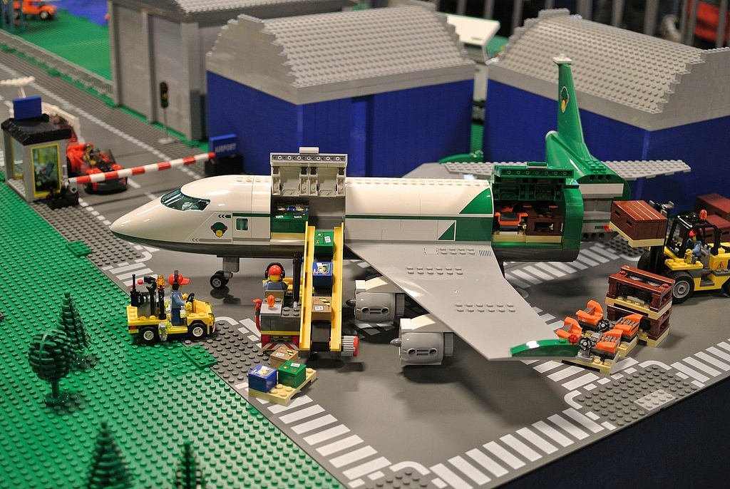 LEGO workers load some JSON decoders onto a plane.