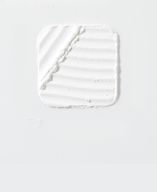 Sulfamethoxazole-Trimethoprim - Light gray backdrop with a fine white powder shaped in a sqaure in the center with diagnol lines cut into the top left, and horizontal wavy lines cut into the remaining area.