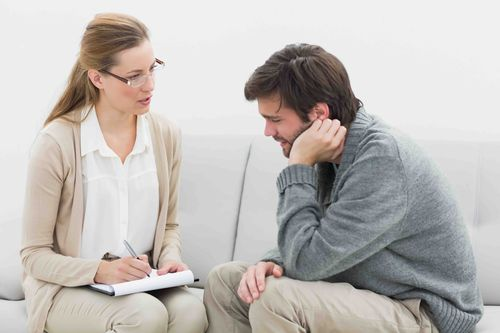 therapist and client in psychotherapy session: Monitor their mood between sessions