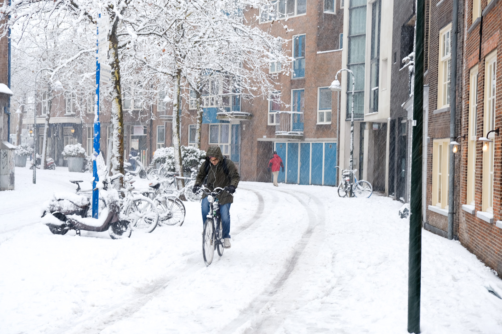 Riding a bike while it's snowing