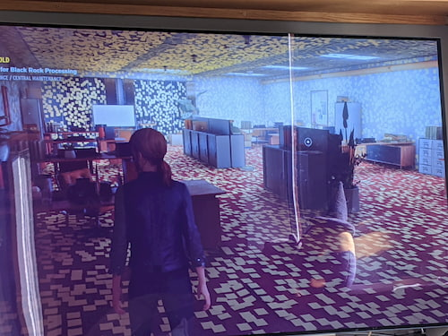 A screenshot of the game Control, with a red-headed player looking at a room entirely covered in yellow post-its