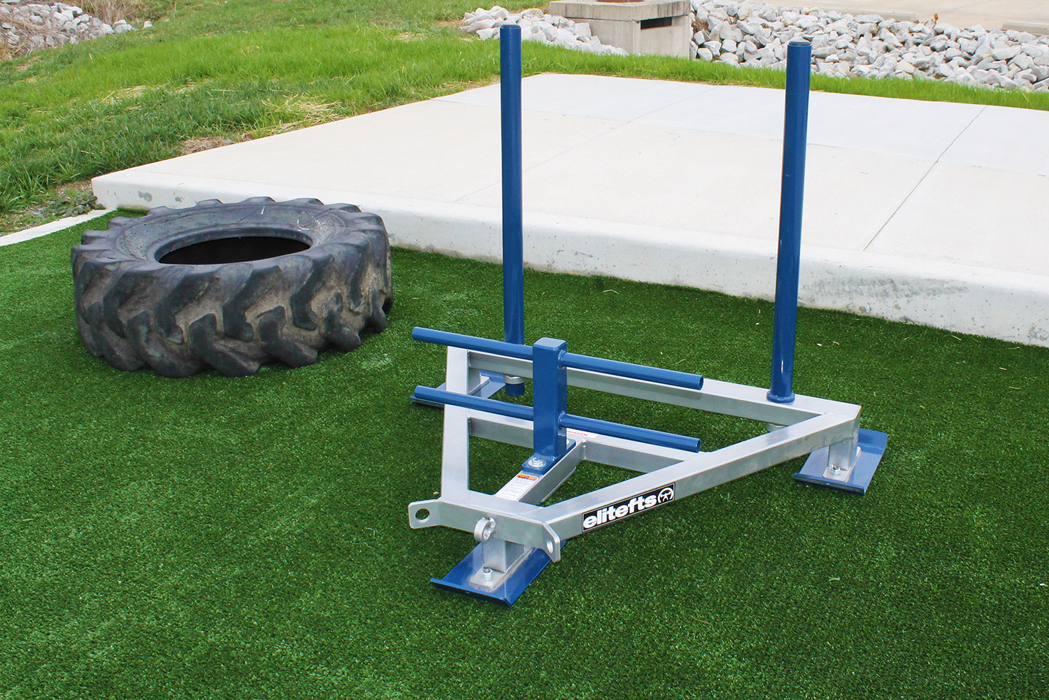 Outdoor fitness area with equipment.