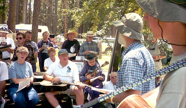 Carl and Luke teach their very first bluegrass festival workshop in Grass Valley, 2003.